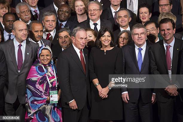 Michael Bloomberg United Nations special envoy for cities and climate change and founder of Bloomberg LP third left and Anne Hidalgo mayor of Paris...