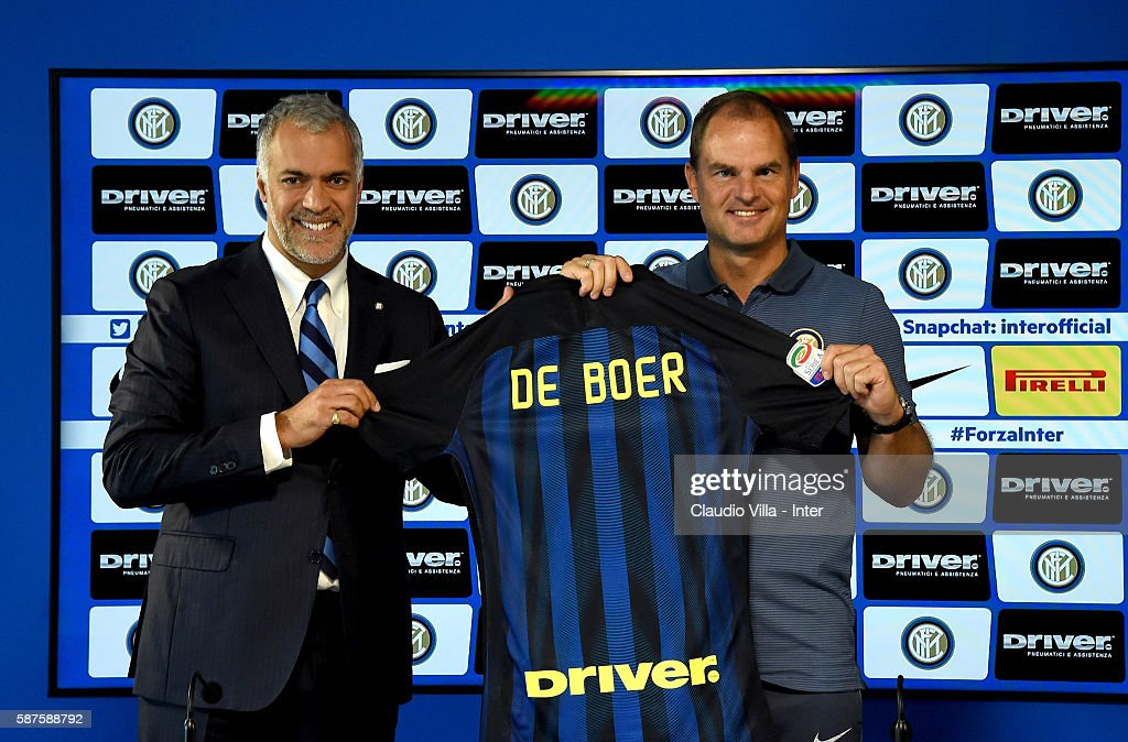 Michael Bolingbroke (L) and Frank de Boer pose for a photo during FC Internazionale Unveils New Coach Frank De Boer at Appiano Gentile on August 9, 2016 in Como, Italy.