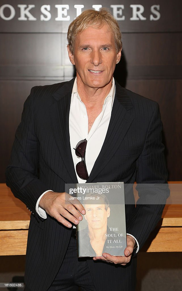 <a gi-track='captionPersonalityLinkClicked' href=/galleries/search?phrase=Michael+Bolton&family=editorial&specificpeople=208230 ng-click='$event.stopPropagation()'>Michael Bolton</a> signs copies of his book 'The Soul Of It All: My Music, My Life' held at the Barnes & Noble bookstore at The Grove on February 11, 2013 in Los Angeles, California.