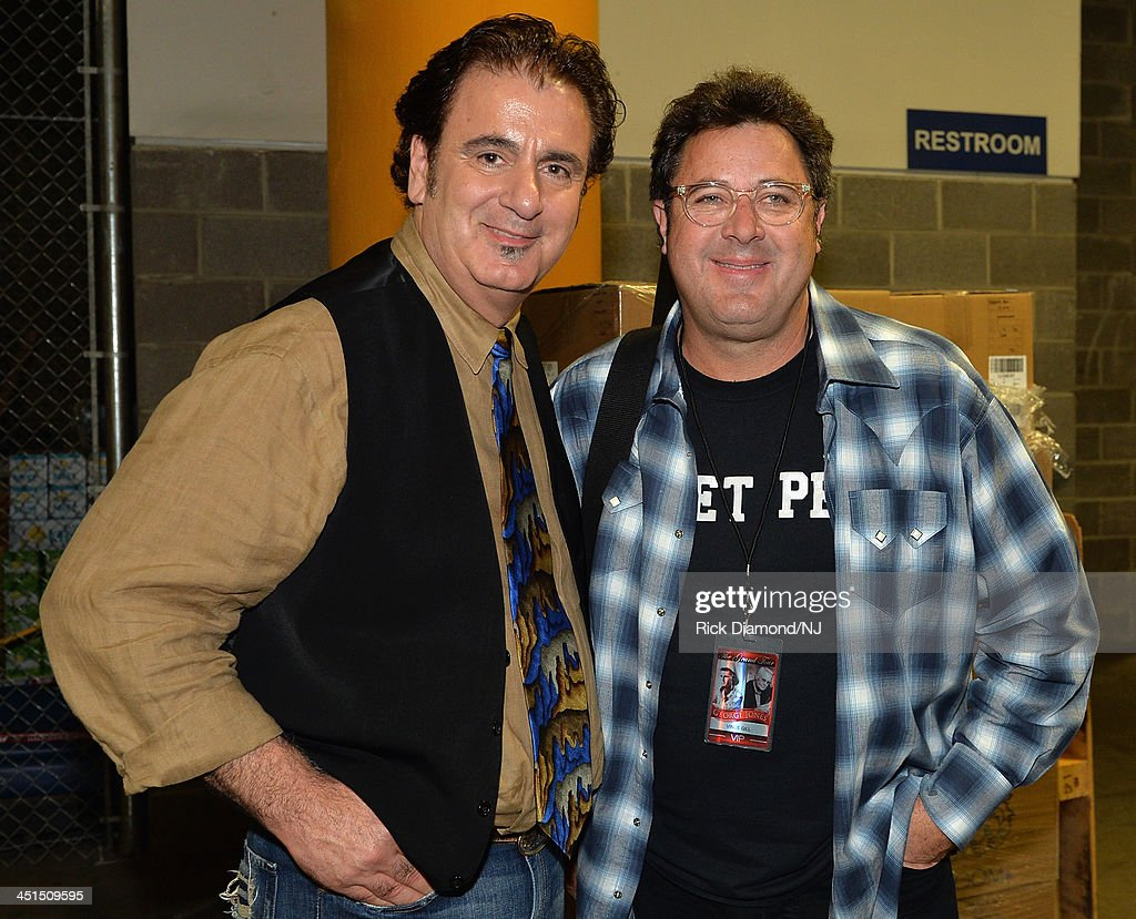 Michael Bonaguro and <a gi-track='captionPersonalityLinkClicked' href=/galleries/search?phrase=Vince+Gill&family=editorial&specificpeople=215309 ng-click='$event.stopPropagation()'>Vince Gill</a> attend Playin' Possum! The Final No Show Tribute To George Jones at Bridgestone Arena on November 22, 2013 in Nashville, Tennessee.