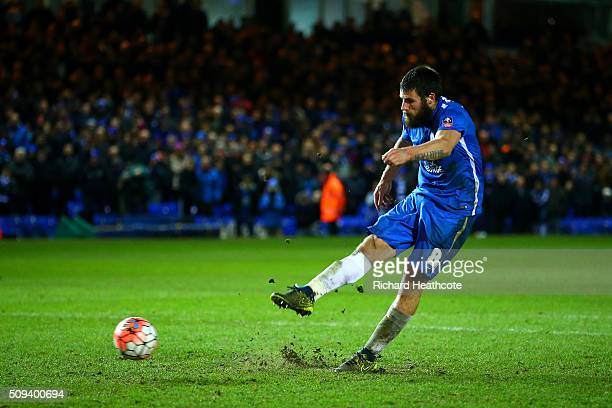 Michael Bostwick of Peterborough scores a goal during the penalty shootout in the Emirates FA Cup fourth round replay match between Peterborough...