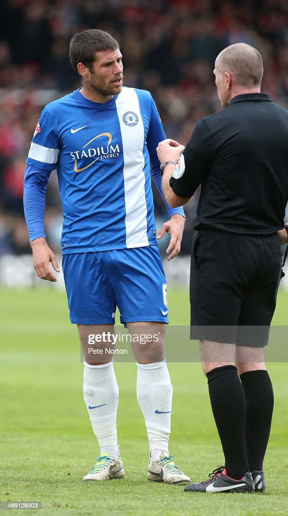 Michael Bostwick of Peterborough United makes a point to referee Graham Salisbury during the Sky Bet League One Semi Final First Leg between Peterborough United and Leyton Orient at London Road Stadium on May 10, 2014 in Peterborough, England.