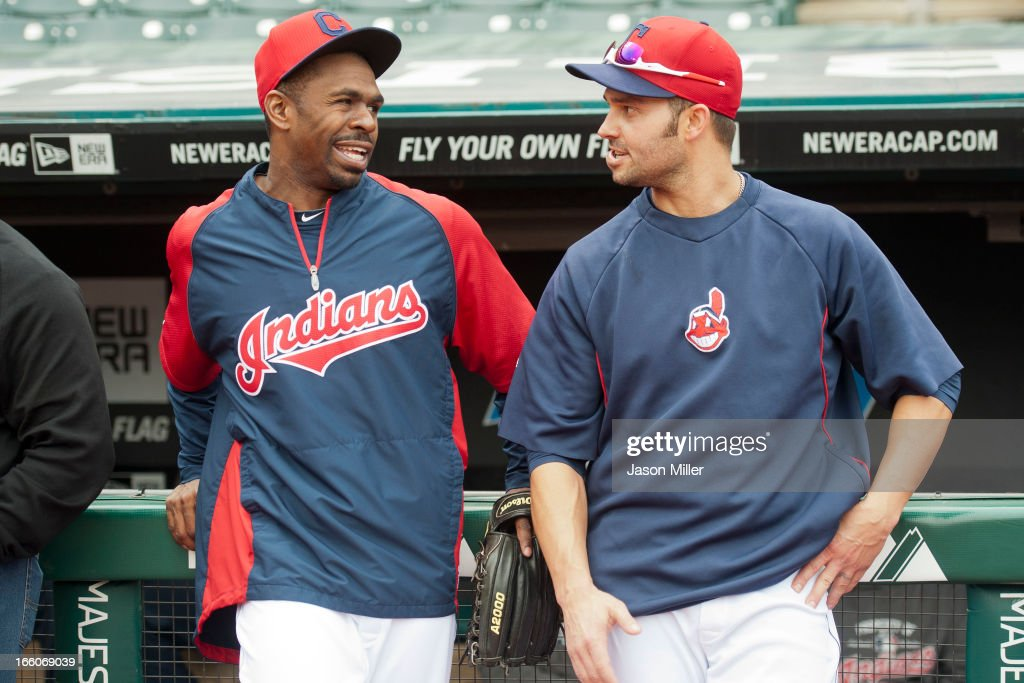 Michael Bourn #24 and Nick Swisher #33 of the Cleveland Indians talk prior to the start of the game against the New York Yankees on opening day at Progressive Field on April 8, 2013 in Cleveland, Ohio.