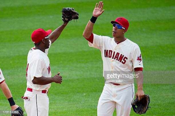 Michael Bourn celebrates with Michael Brantley of the Cleveland Indians after the Indians defeated the Detroit Tigers at Progressive Field on July 7...