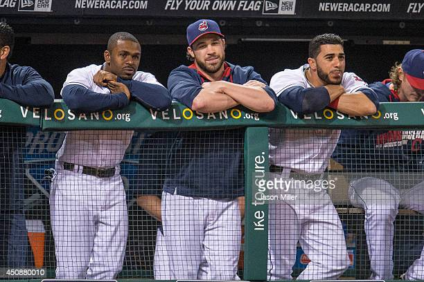 Michael Bourn Jason Kipnis and Mike Aviles of the Cleveland Indians watch from the dugout in the sixth inning during the game against the Detroit...