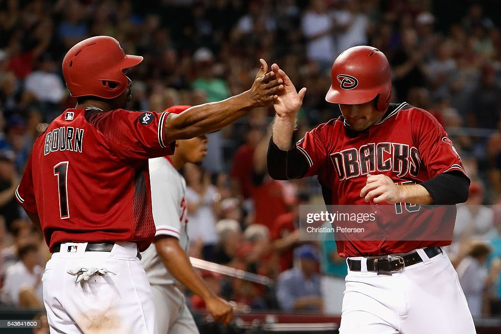 <a gi-track='captionPersonalityLinkClicked' href=/galleries/search?phrase=Michael+Bourn&family=editorial&specificpeople=835742 ng-click='$event.stopPropagation()'>Michael Bourn</a> #1 of the Arizona Diamondbacks high-fives Phil Gosselin #15 after both scored runs against the Philadelphia Phillies during the seventh inning of the MLB game at Chase Field on June 29, 2016 in Phoenix, Arizona.