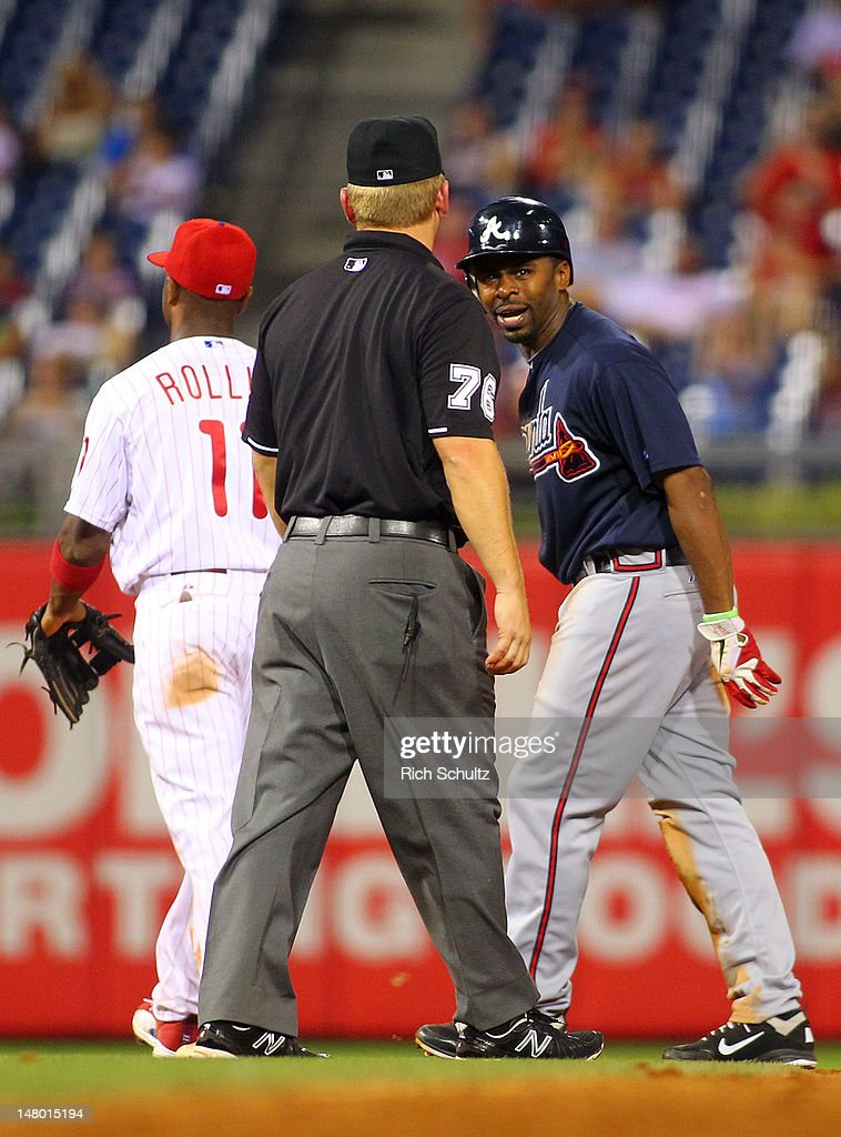 <a gi-track='captionPersonalityLinkClicked' href=/galleries/search?phrase=Michael+Bourn&family=editorial&specificpeople=835742 ng-click='$event.stopPropagation()'>Michael Bourn</a> #24 of the Atlanta Braves argues with second base umpire Mike Muchlinski #76 after being called out attempting to steal second base against the Philadelphia Phillies during a MLB baseball game on July 7, 2012 at Citizens Bank Park in Philadelphia, Pennsylvania. The Braves defeated the Phillies 6-3.