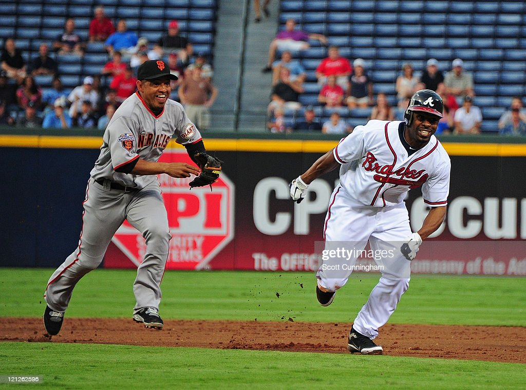 <a gi-track='captionPersonalityLinkClicked' href=/galleries/search?phrase=Michael+Bourn&family=editorial&specificpeople=835742 ng-click='$event.stopPropagation()'>Michael Bourn</a> #24 of the Atlanta Braves gets caught in a rundown with <a gi-track='captionPersonalityLinkClicked' href=/galleries/search?phrase=Orlando+Cabrera&family=editorial&specificpeople=175863 ng-click='$event.stopPropagation()'>Orlando Cabrera</a> #43 of the San Francisco Giants at Turner Field on August 16, 2011 in Atlanta, Georgia.