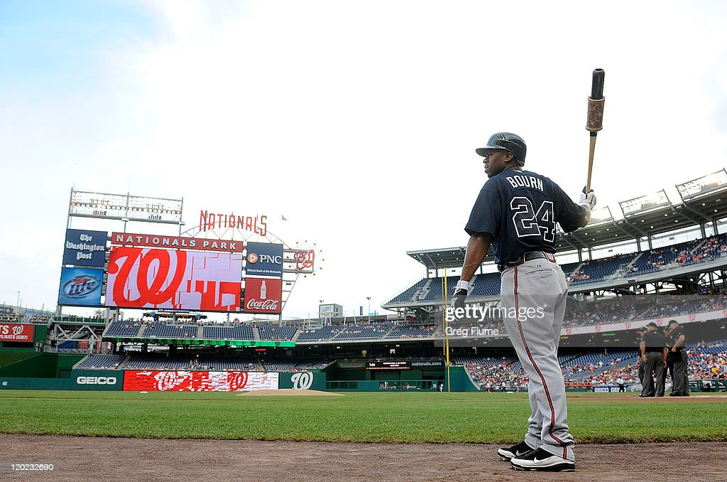 <a gi-track='captionPersonalityLinkClicked' href=/galleries/search?phrase=Michael+Bourn&family=editorial&specificpeople=835742 ng-click='$event.stopPropagation()'>Michael Bourn</a> #24 of the Atlanta Braves gets ready to bat in the first inning against the Washington Nationals at Nationals Park on August 1, 2011 in Washington, DC.