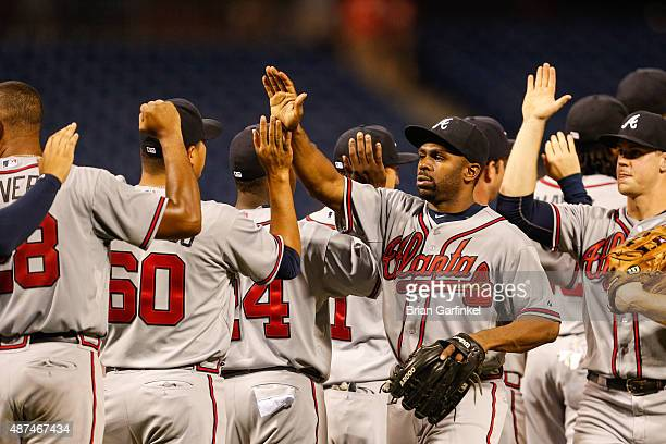 Michael Bourn of the Atlanta Braves highfives teammates after the game against the Philadelphia Phillies at Citizens Bank Park on September 9 2015 in...