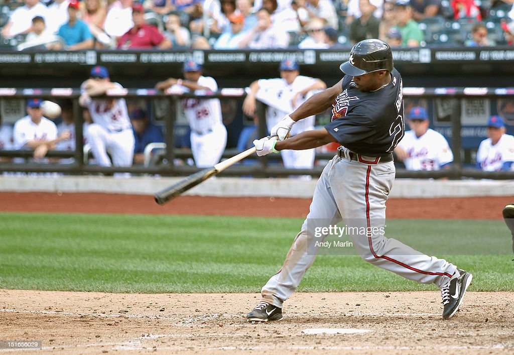 <a gi-track='captionPersonalityLinkClicked' href=/galleries/search?phrase=Michael+Bourn&family=editorial&specificpeople=835742 ng-click='$event.stopPropagation()'>Michael Bourn</a> #24 of the Atlanta Braves hits a first inning single against the New York Mets at Citi Field on September 9, 2012 in the Flushing neighborhood of the Queens borough of New York City.