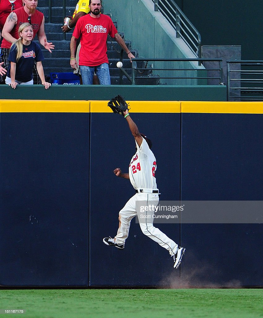 <a gi-track='captionPersonalityLinkClicked' href=/galleries/search?phrase=Michael+Bourn&family=editorial&specificpeople=835742 ng-click='$event.stopPropagation()'>Michael Bourn</a> #24 of the Atlanta Braves makes a catch against the Philadelphia Phillies at Turner Field on September 2 2012 in Atlanta, Georgia.