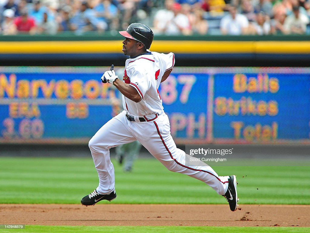 <a gi-track='captionPersonalityLinkClicked' href=/galleries/search?phrase=Michael+Bourn&family=editorial&specificpeople=835742 ng-click='$event.stopPropagation()'>Michael Bourn</a> of the Atlanta Braves pulls in to second base for a first inning double against the Milwaukee Brewers at Turner Field on April 15, 2012 in Atlanta, Georgia. All uniformed team members are wearing jersey number 42 in honor of Jackie Robinson Day.