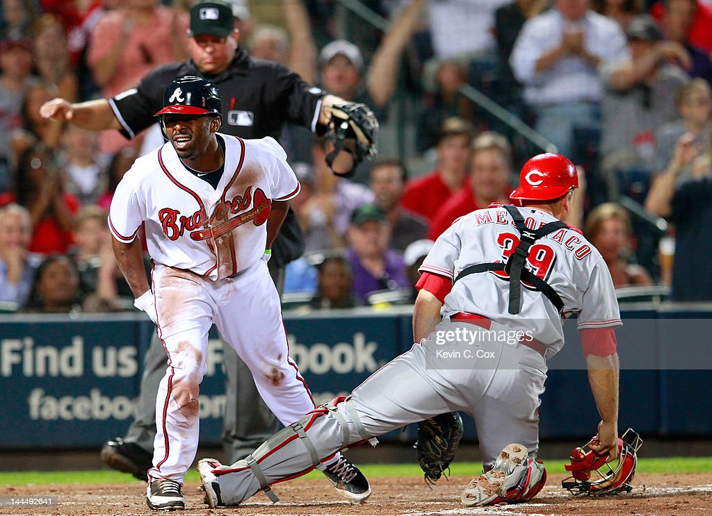 <a gi-track='captionPersonalityLinkClicked' href=/galleries/search?phrase=Michael+Bourn&family=editorial&specificpeople=835742 ng-click='$event.stopPropagation()'>Michael Bourn</a> #24 of the Atlanta Braves reacts after scoring against <a gi-track='captionPersonalityLinkClicked' href=/galleries/search?phrase=Devin+Mesoraco&family=editorial&specificpeople=5745587 ng-click='$event.stopPropagation()'>Devin Mesoraco</a> #39 of the Cincinnati Reds in the fifth inning at Turner Field on May 14, 2012 in Atlanta, Georgia.