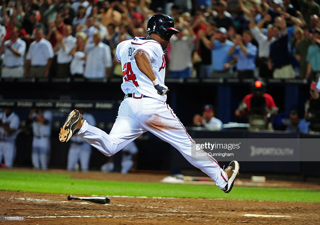 <a gi-track='captionPersonalityLinkClicked' href=/galleries/search?phrase=Michael+Bourn&family=editorial&specificpeople=835742 ng-click='$event.stopPropagation()'>Michael Bourn</a> #24 of the Atlanta Braves scores a ninth inning run against the Philadelphia Phillies at Turner Field on May 2, 2012 in Atlanta, Georgia.