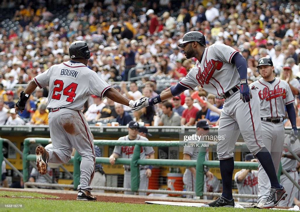 <a gi-track='captionPersonalityLinkClicked' href=/galleries/search?phrase=Michael+Bourn&family=editorial&specificpeople=835742 ng-click='$event.stopPropagation()'>Michael Bourn</a> #24 of the Atlanta Braves scores in the sixth inning against the Pittsburgh Pirates during the game on October 3, 2012 at PNC Park in Pittsburgh, Pennsylvania.