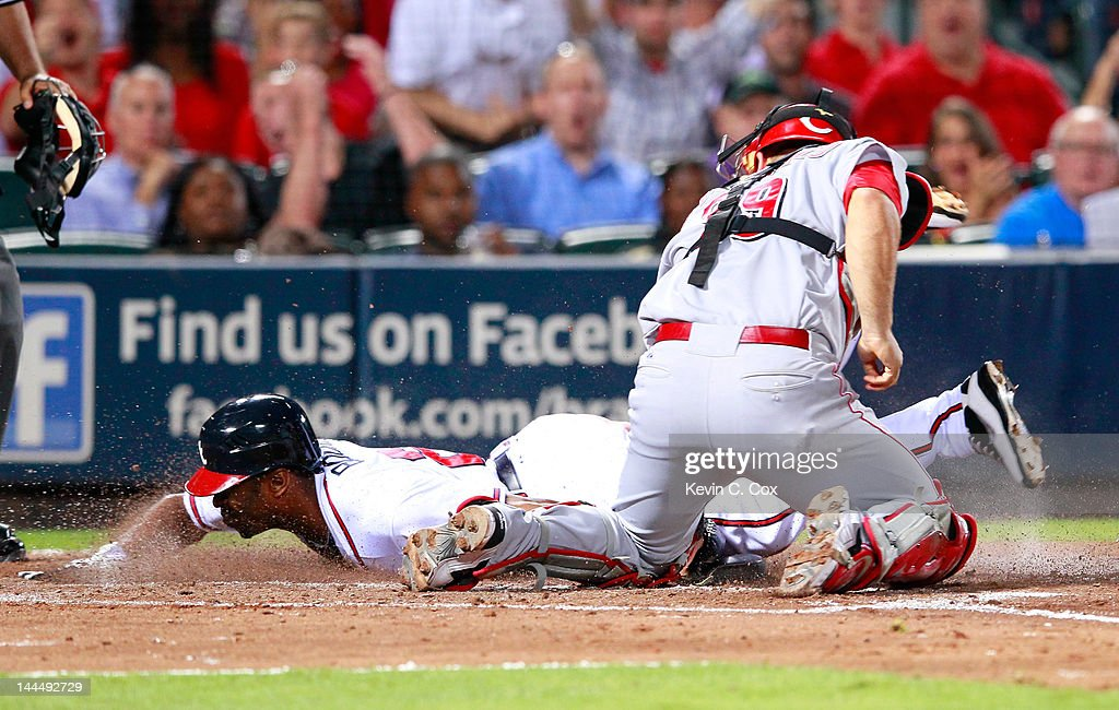 <a gi-track='captionPersonalityLinkClicked' href=/galleries/search?phrase=Michael+Bourn&family=editorial&specificpeople=835742 ng-click='$event.stopPropagation()'>Michael Bourn</a> #24 of the Atlanta Braves slides in safely at home in the fifth inning against <a gi-track='captionPersonalityLinkClicked' href=/galleries/search?phrase=Devin+Mesoraco&family=editorial&specificpeople=5745587 ng-click='$event.stopPropagation()'>Devin Mesoraco</a> #39 of the Cincinnati Reds at Turner Field on May 14, 2012 in Atlanta, Georgia.