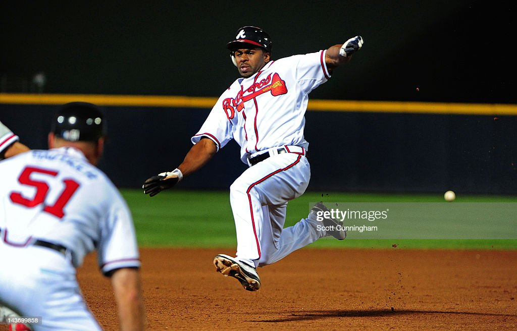 <a gi-track='captionPersonalityLinkClicked' href=/galleries/search?phrase=Michael+Bourn&family=editorial&specificpeople=835742 ng-click='$event.stopPropagation()'>Michael Bourn</a> #24 of the Atlanta Braves slides into third base against the Philadelphia Phillies at Turner Field on May 2, 2012 in Atlanta, Georgia.