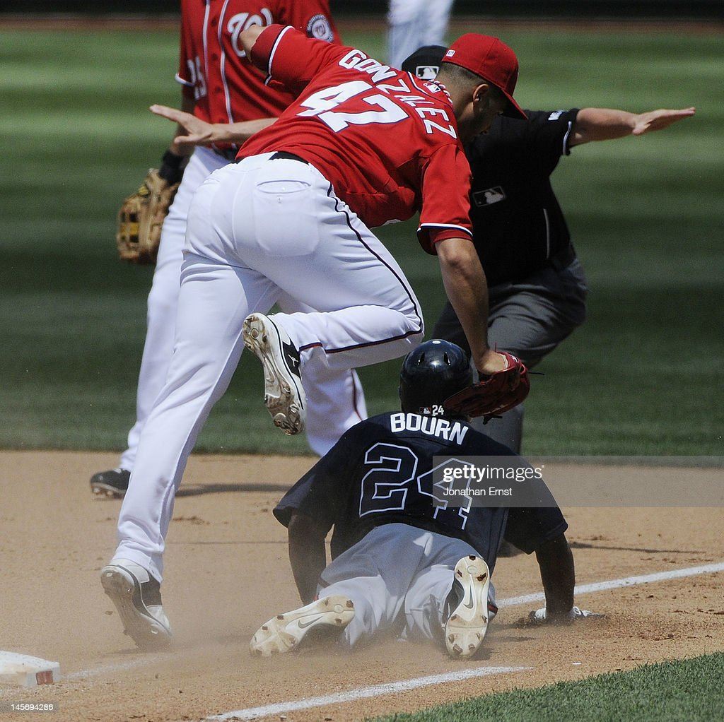 <a gi-track='captionPersonalityLinkClicked' href=/galleries/search?phrase=Michael+Bourn&family=editorial&specificpeople=835742 ng-click='$event.stopPropagation()'>Michael Bourn</a> #24 (BOTTOM) of the Atlanta Braves slides safely under an attempted force out by Washington Nationals pitcher <a gi-track='captionPersonalityLinkClicked' href=/galleries/search?phrase=Gio+Gonzalez&family=editorial&specificpeople=759378 ng-click='$event.stopPropagation()'>Gio Gonzalez</a> (TOP) in the fifth inning of their game at Nationals Park on June 3, 2012 in Washington, DC.