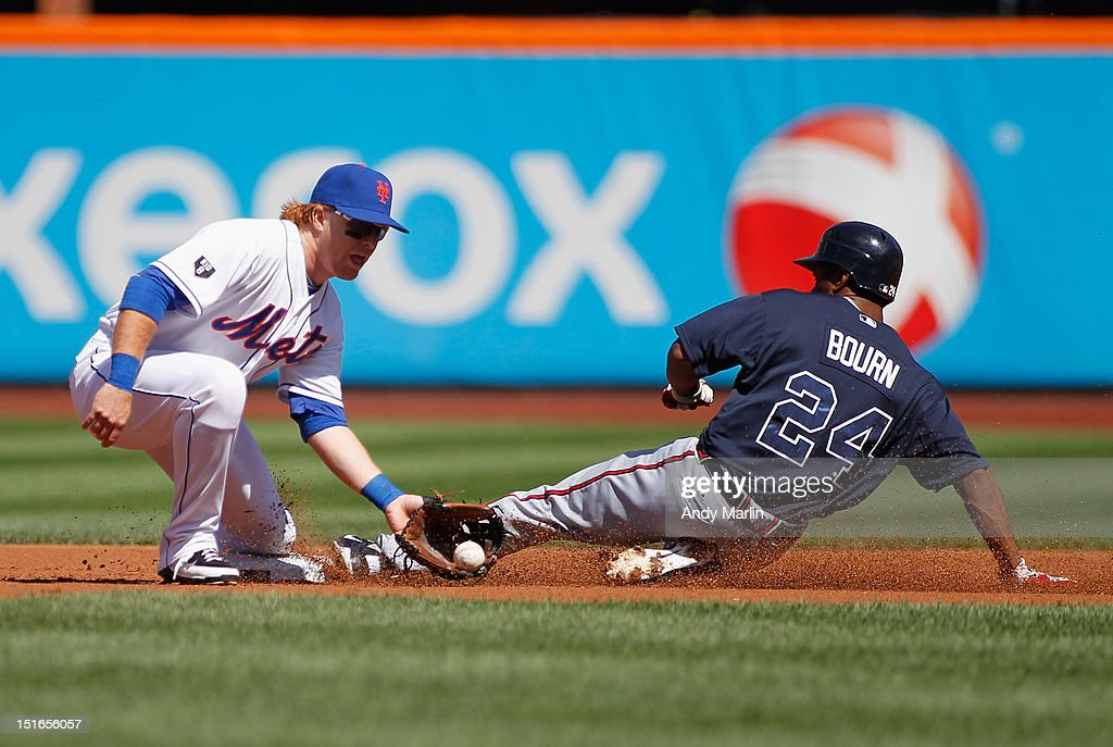 <a gi-track='captionPersonalityLinkClicked' href=/galleries/search?phrase=Michael+Bourn&family=editorial&specificpeople=835742 ng-click='$event.stopPropagation()'>Michael Bourn</a> #24 of the Atlanta Braves steals second base against the New York Mets at Citi Field on September 9, 2012 in the Flushing neighborhood of the Queens borough of New York City.