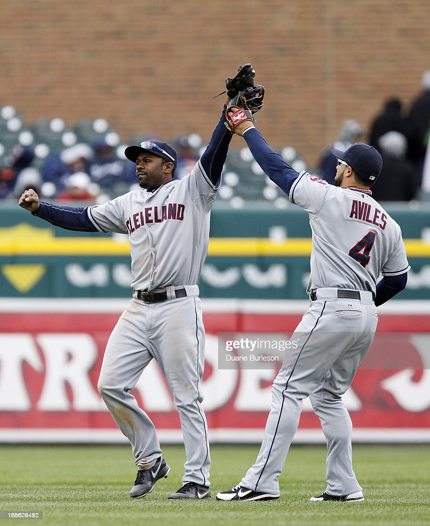 <a gi-track='captionPersonalityLinkClicked' href=/galleries/search?phrase=Michael+Bourn&family=editorial&specificpeople=835742 ng-click='$event.stopPropagation()'>Michael Bourn</a> #24 of the Cleveland Indians and <a gi-track='captionPersonalityLinkClicked' href=/galleries/search?phrase=Mike+Aviles&family=editorial&specificpeople=4944765 ng-click='$event.stopPropagation()'>Mike Aviles</a> #4 celebrate a 4-3 win over the Detroit Tigers in 10 inning at Comerica Park on May 12, 2013 in Detroit, Michigan. Bourn scored the tying run in the ninth inning to force extra innings.