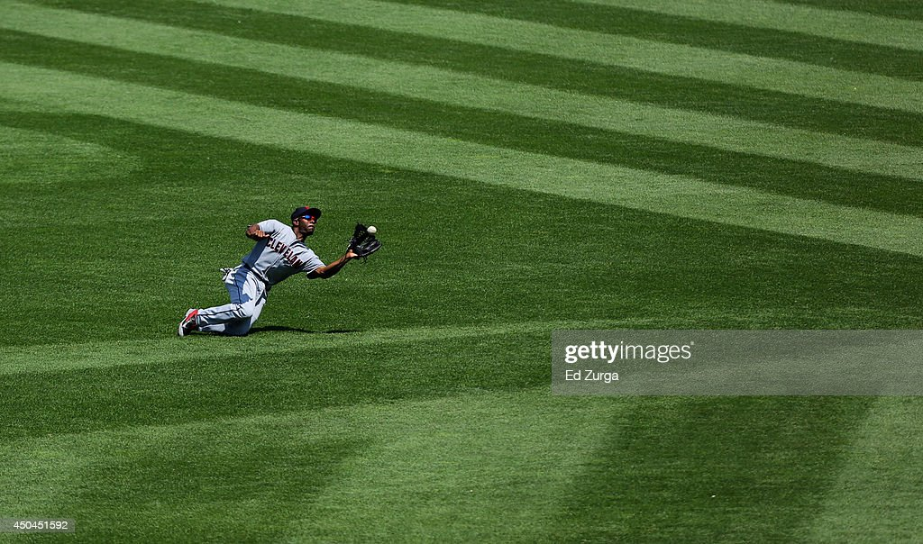 <a gi-track='captionPersonalityLinkClicked' href=/galleries/search?phrase=Michael+Bourn&family=editorial&specificpeople=835742 ng-click='$event.stopPropagation()'>Michael Bourn</a> #24 of the Cleveland Indians catches a ball hit by <a gi-track='captionPersonalityLinkClicked' href=/galleries/search?phrase=Alex+Gordon+-+Baseball+Player&family=editorial&specificpeople=4494252 ng-click='$event.stopPropagation()'>Alex Gordon</a> of the Kansas City Royals in the fifth inning at Kauffman Stadium on June 11, 2014 in Kansas City, Missouri.