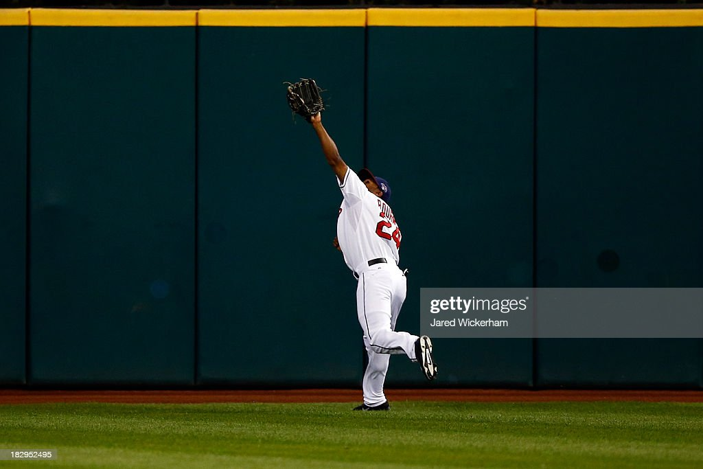 <a gi-track='captionPersonalityLinkClicked' href=/galleries/search?phrase=Michael+Bourn&family=editorial&specificpeople=835742 ng-click='$event.stopPropagation()'>Michael Bourn</a> #24 of the Cleveland Indians catches a fly ball to center field by David DeJesus #7 of the Tampa Bay Rays in the first inning during the American League Wild Card game at Progressive Field on October 2, 2013 in Cleveland, Ohio.