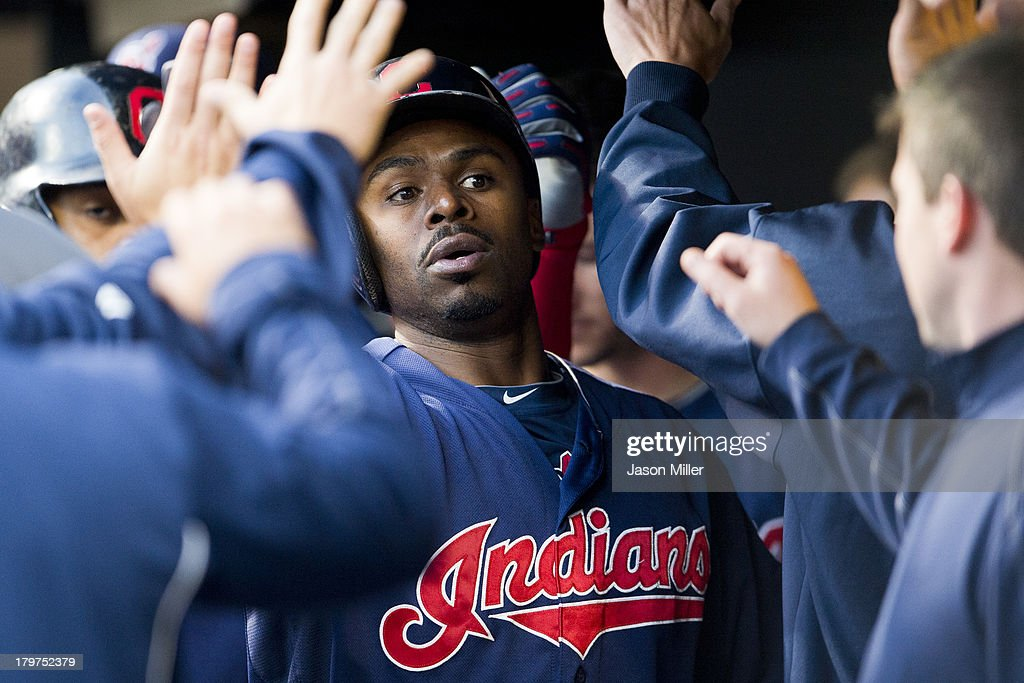 <a gi-track='captionPersonalityLinkClicked' href=/galleries/search?phrase=Michael+Bourn&family=editorial&specificpeople=835742 ng-click='$event.stopPropagation()'>Michael Bourn</a> #24 of the Cleveland Indians celebrates in the dugout after scoring on a sacrifice fly by teammate Carlos Santana #41 during the first inning against the New York Mets at Progressive Field on September 6, 2013 in Cleveland, Ohio.