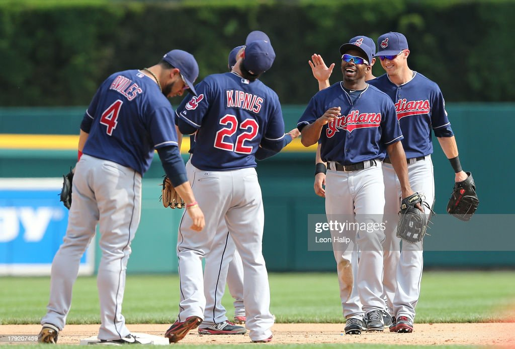 Michael Bourn #24 of the Cleveland Indians celebrates with his teammates after defeating the Detroit Tigers at Comerica Park on September 1, 2013 in Detroit, Michigan. The Indians defeated the Tigers 4-0.