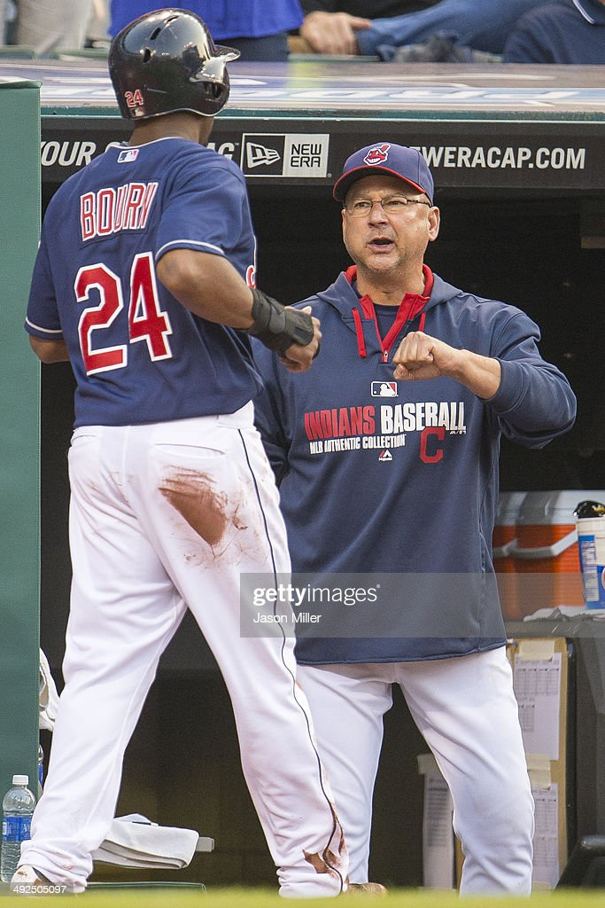 <a gi-track='captionPersonalityLinkClicked' href=/galleries/search?phrase=Michael+Bourn&family=editorial&specificpeople=835742 ng-click='$event.stopPropagation()'>Michael Bourn</a> #24 of the Cleveland Indians celebrates with manager Terry Francona #17 after Bourn scored during the second inning against the Detroit Tigers at Progressive Field on May 20, 2014 in Cleveland, Ohio.