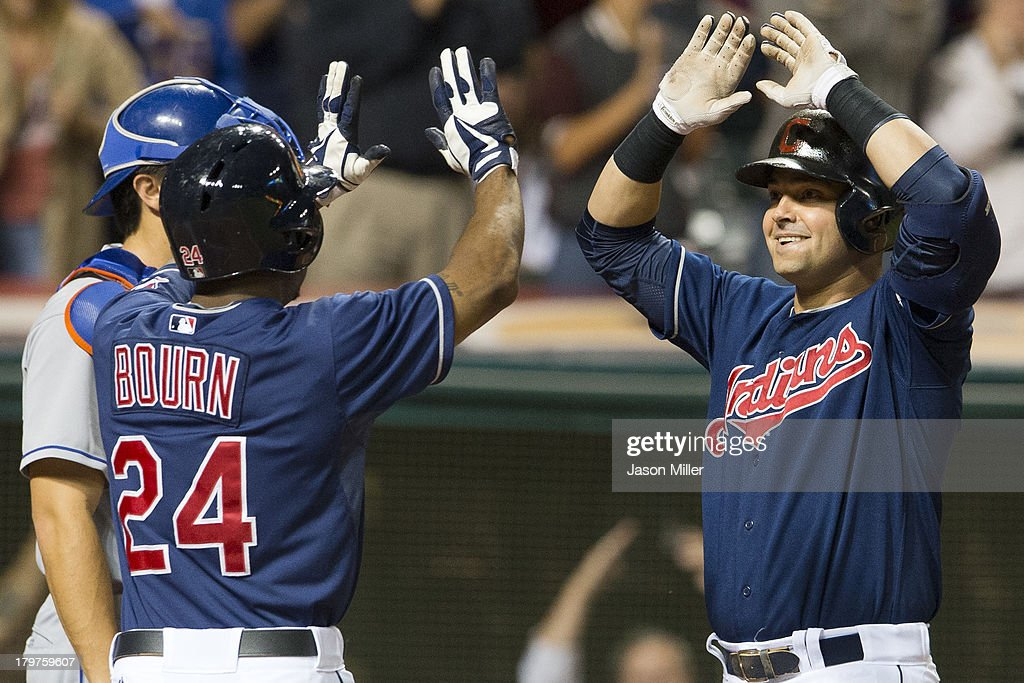<a gi-track='captionPersonalityLinkClicked' href=/galleries/search?phrase=Michael+Bourn&family=editorial&specificpeople=835742 ng-click='$event.stopPropagation()'>Michael Bourn</a> #24 of the Cleveland Indians celebrates with <a gi-track='captionPersonalityLinkClicked' href=/galleries/search?phrase=Nick+Swisher&family=editorial&specificpeople=206417 ng-click='$event.stopPropagation()'>Nick Swisher</a> #33 after Swisher hit a grand slam during the eighth inning against the New York Mets at Progressive Field on September 6, 2013 in Cleveland, Ohio.