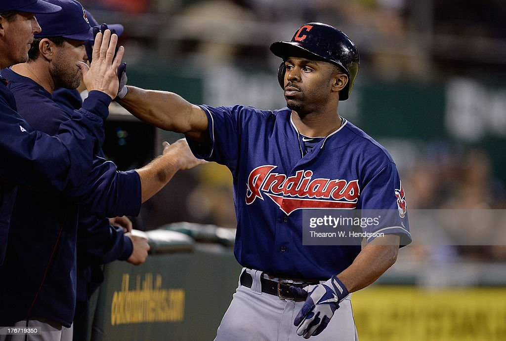 <a gi-track='captionPersonalityLinkClicked' href=/galleries/search?phrase=Michael+Bourn&family=editorial&specificpeople=835742 ng-click='$event.stopPropagation()'>Michael Bourn</a> #24 of the Cleveland Indians is congratulated by teammates after he hit a solo home run in the seventh inning against the Oakland Athletics at O.co Coliseum on August 17, 2013 in Oakland, California.