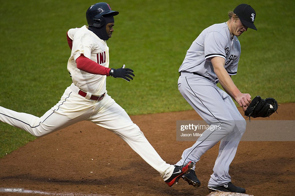 <a gi-track='captionPersonalityLinkClicked' href=/galleries/search?phrase=Michael+Bourn&family=editorial&specificpeople=835742 ng-click='$event.stopPropagation()'>Michael Bourn</a> #24 of the Cleveland Indians is out at first as relief pitcher Addison Reed #43 of the Chicago White Sox tags first during the eighth inning at Progressive Field on April 13, 2013 in Cleveland, Ohio. The Indians defeated the White Sox 9-4.