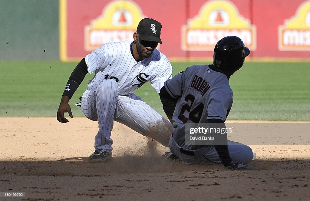 <a gi-track='captionPersonalityLinkClicked' href=/galleries/search?phrase=Michael+Bourn&family=editorial&specificpeople=835742 ng-click='$event.stopPropagation()'>Michael Bourn</a> #24 of the Cleveland Indians is tagged out by <a gi-track='captionPersonalityLinkClicked' href=/galleries/search?phrase=Alexei+Ramirez&family=editorial&specificpeople=690568 ng-click='$event.stopPropagation()'>Alexei Ramirez</a> #10 of the Chicago White Sox on a steal attempt of second base during the ninth inning on September 13, 2013 at U.S. Cellular Field in Chicago, Illinois. The Cleveland Indians defeated the Chicago White Sox 3-1.