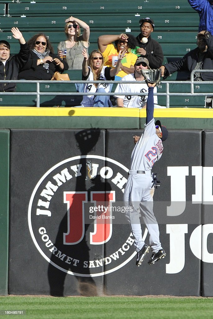 <a gi-track='captionPersonalityLinkClicked' href=/galleries/search?phrase=Michael+Bourn&family=editorial&specificpeople=835742 ng-click='$event.stopPropagation()'>Michael Bourn</a> #24 of the Cleveland Indians makes a leaping catch on Jordan Danks #20 of the Chicago White Sox during the ninth inning on September 13, 2013 at U.S. Cellular Field in Chicago, Illinois. The Cleveland Indians defeated the Chicago White Sox 3-1.