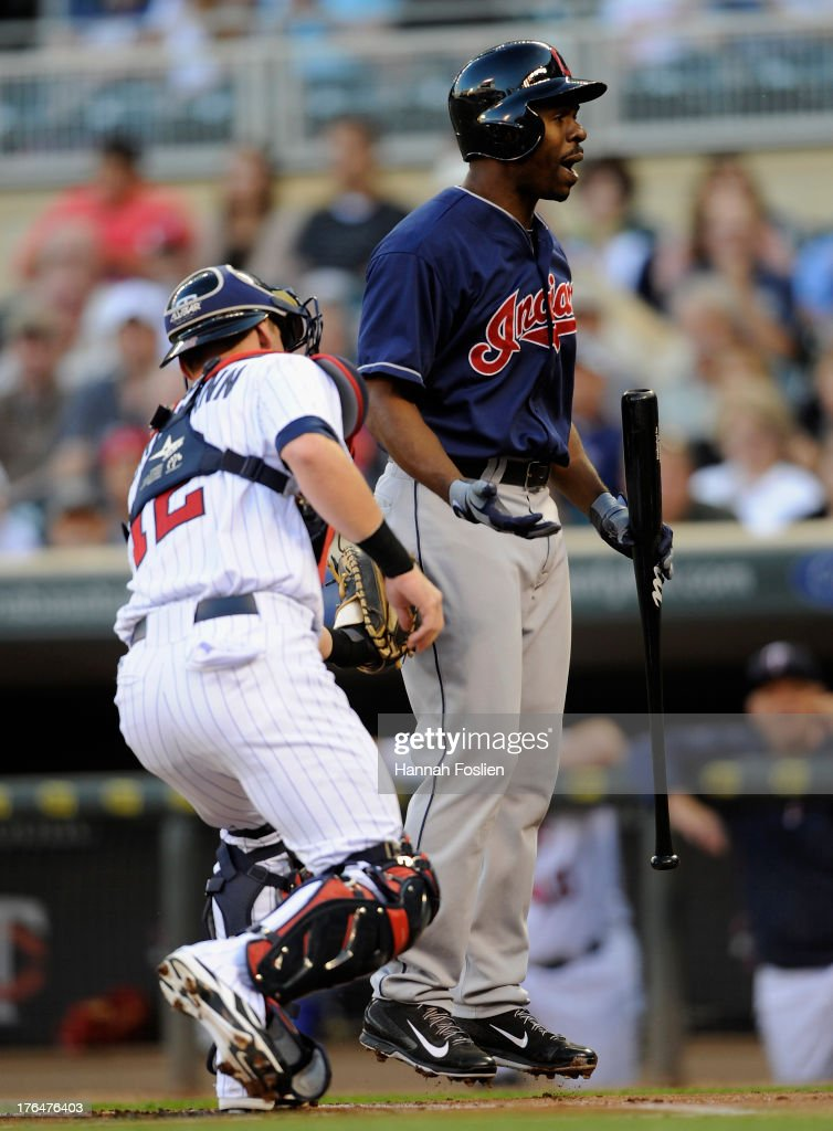 <a gi-track='captionPersonalityLinkClicked' href=/galleries/search?phrase=Michael+Bourn&family=editorial&specificpeople=835742 ng-click='$event.stopPropagation()'>Michael Bourn</a> #24 of the Cleveland Indians reacts as <a gi-track='captionPersonalityLinkClicked' href=/galleries/search?phrase=Chris+Herrmann+-+Baseball+Player&family=editorial&specificpeople=7553012 ng-click='$event.stopPropagation()'>Chris Herrmann</a> #12 of the Minnesota Twins tags him out during the first inning of the game on August 13, 2013 at Target Field in Minneapolis, Minnesota.