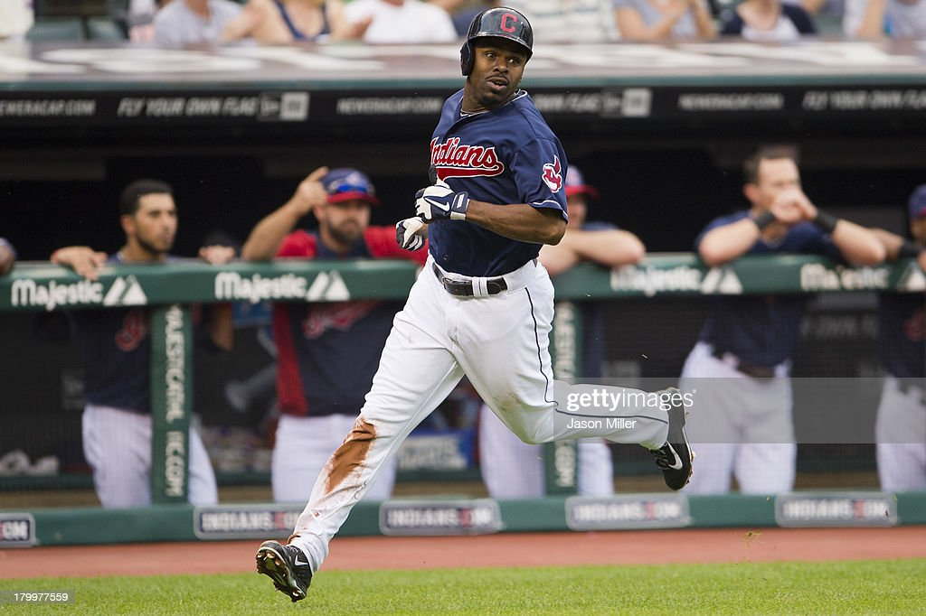 <a gi-track='captionPersonalityLinkClicked' href=/galleries/search?phrase=Michael+Bourn&family=editorial&specificpeople=835742 ng-click='$event.stopPropagation()'>Michael Bourn</a> #24 of the Cleveland Indians round third base on his way home off a double by Nick Swisher #33 during the first inning at Progressive Field on September 7, 2013 in Cleveland, Ohio.
