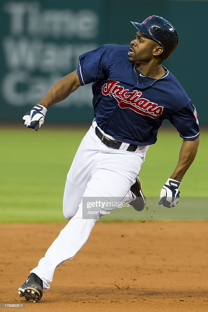 <a gi-track='captionPersonalityLinkClicked' href=/galleries/search?phrase=Michael+Bourn&family=editorial&specificpeople=835742 ng-click='$event.stopPropagation()'>Michael Bourn</a> #24 of the Cleveland Indians rounds second on a double hit by Nick Swisher #33 during the fifth inning against the Chicago White Sox at Progressive Field on July 30, 2013 in Cleveland, Ohio.