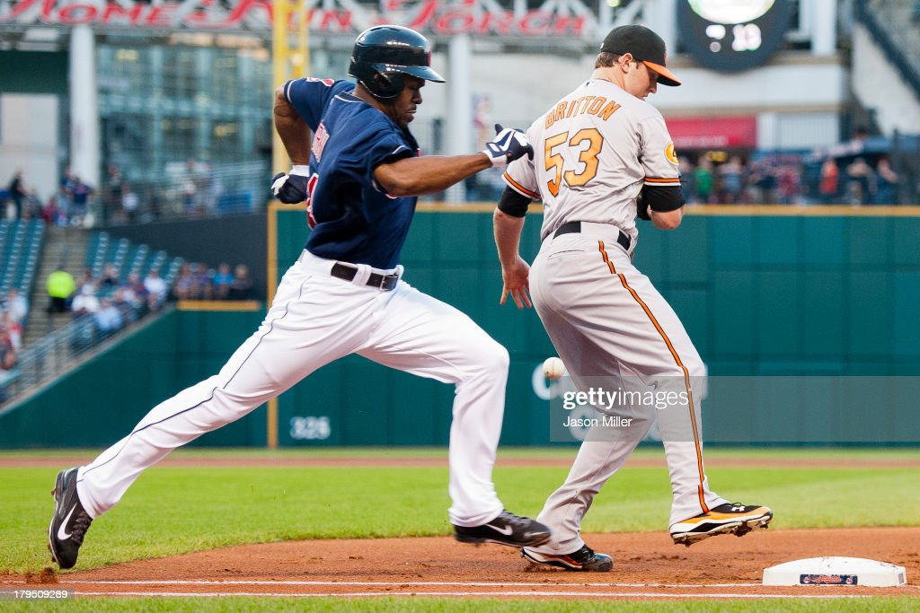 <a gi-track='captionPersonalityLinkClicked' href=/galleries/search?phrase=Michael+Bourn&family=editorial&specificpeople=835742 ng-click='$event.stopPropagation()'>Michael Bourn</a> #24 of the Cleveland Indians runs out a base hit as starting pitcher <a gi-track='captionPersonalityLinkClicked' href=/galleries/search?phrase=Zach+Britton&family=editorial&specificpeople=7091505 ng-click='$event.stopPropagation()'>Zach Britton</a> #53 of the Baltimore Orioles drops the ball during the first inning at Progressive Field on September 4, 2013 in Cleveland, Ohio.