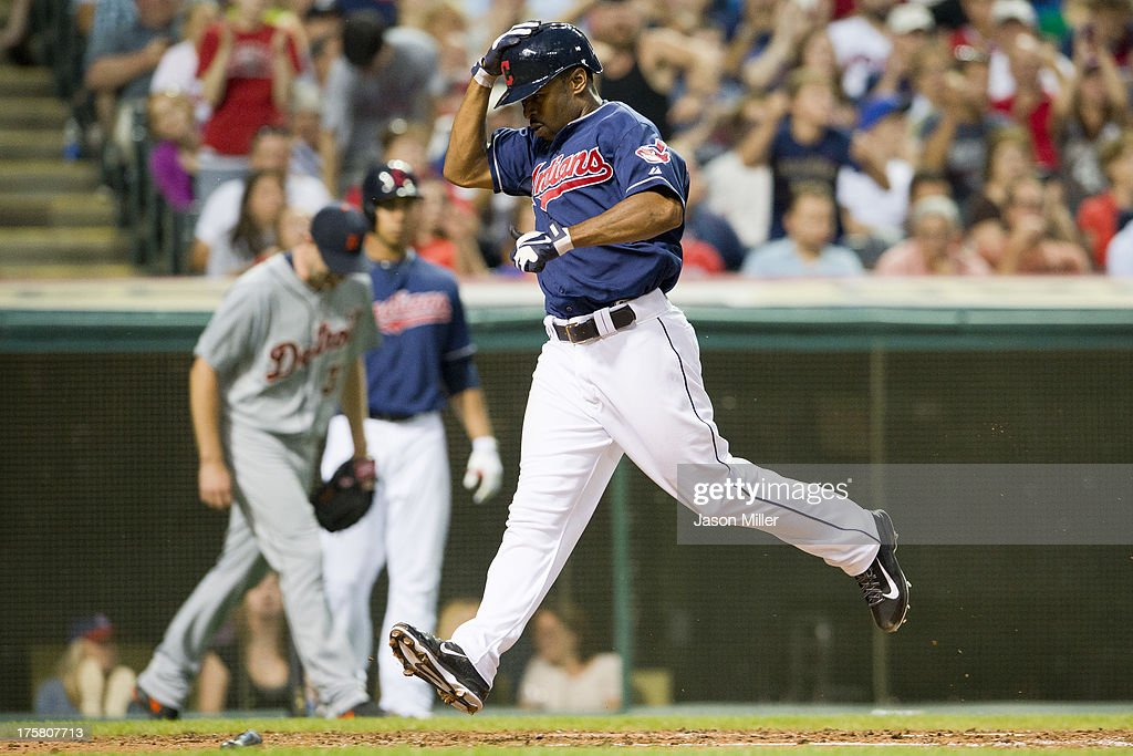 <a gi-track='captionPersonalityLinkClicked' href=/galleries/search?phrase=Michael+Bourn&family=editorial&specificpeople=835742 ng-click='$event.stopPropagation()'>Michael Bourn</a> #24 of the Cleveland Indians scores on a double by Asdrubal Cabrera #13 during the fourth inning against the Detroit Tigers at Progressive Field on August 8, 2013 in Cleveland, Ohio.