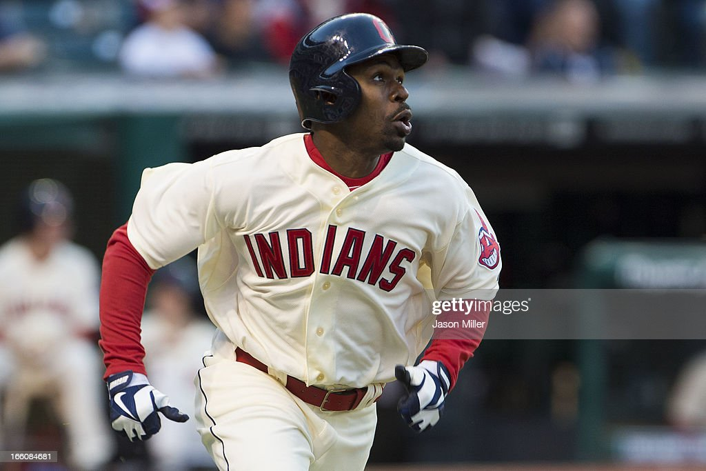 Michael Bourn #24 of the Cleveland Indians watches a hit to deep center for a triple during the eighth inning against the New York Yankees on opening day at Progressive Field on April 8, 2013 in Cleveland, Ohio.