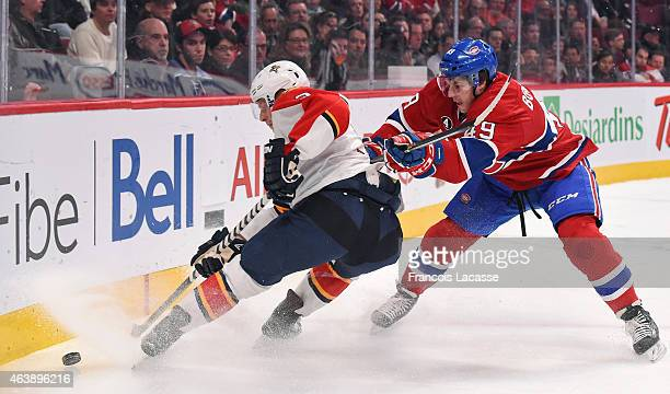 Michael Bournival of the Montreal Canadiens battles for the puck against Steven Kampfer of the Florida Panthers in the NHL game at the Bell Centre on...
