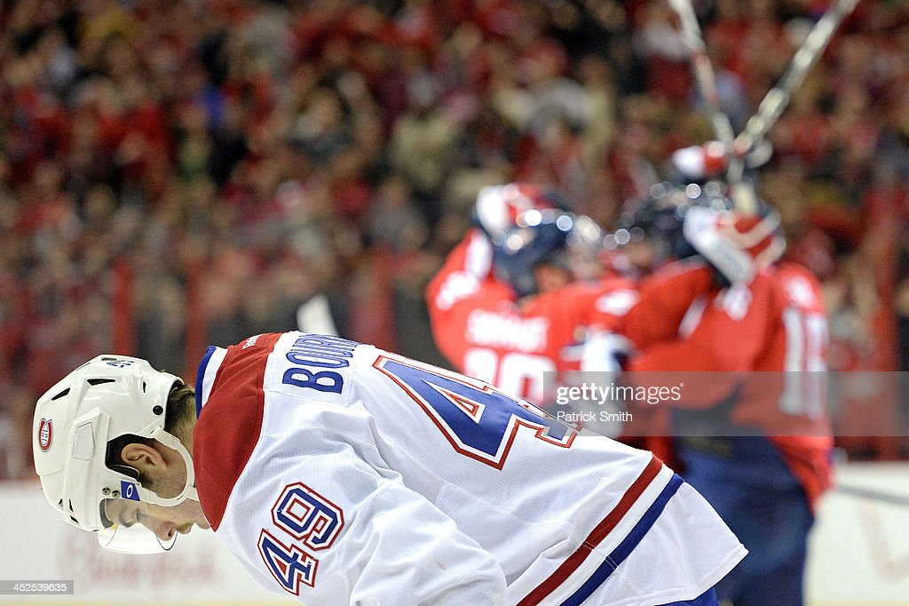 <a gi-track='captionPersonalityLinkClicked' href=/galleries/search?phrase=Michael+Bournival&family=editorial&specificpeople=5646625 ng-click='$event.stopPropagation()'>Michael Bournival</a> #49 of the Montreal Canadiens shows his emotion after <a gi-track='captionPersonalityLinkClicked' href=/galleries/search?phrase=Mikhail+Grabovski&family=editorial&specificpeople=2560547 ng-click='$event.stopPropagation()'>Mikhail Grabovski</a> #84 of the Washington Capitals scored a goal in the third period during an NHL game at the Verizon Center on November 29, 2013 in Washington, DC.
