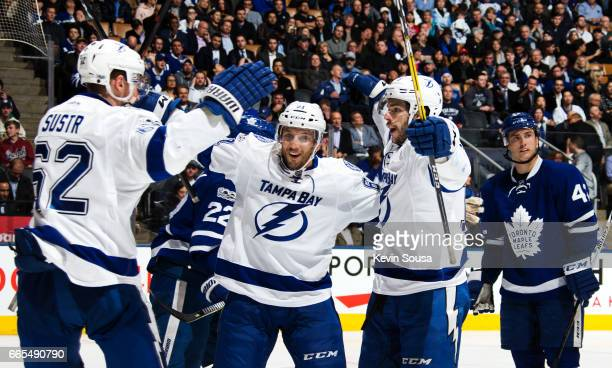 Michael Bournival of the Tampa Bay Lightning celebrates his goal against the Toronto Maple Leafs with teammates Andrej Sustr and Gabriel Dumont...