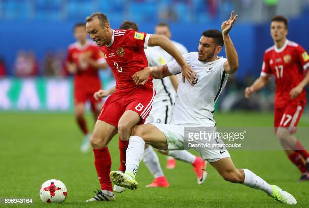 Michael Boxall of New Zealand attempts to tackles Dennis Glushakov of Russia during the FIFA Confederations Cup Russia 2017 Group A match between...