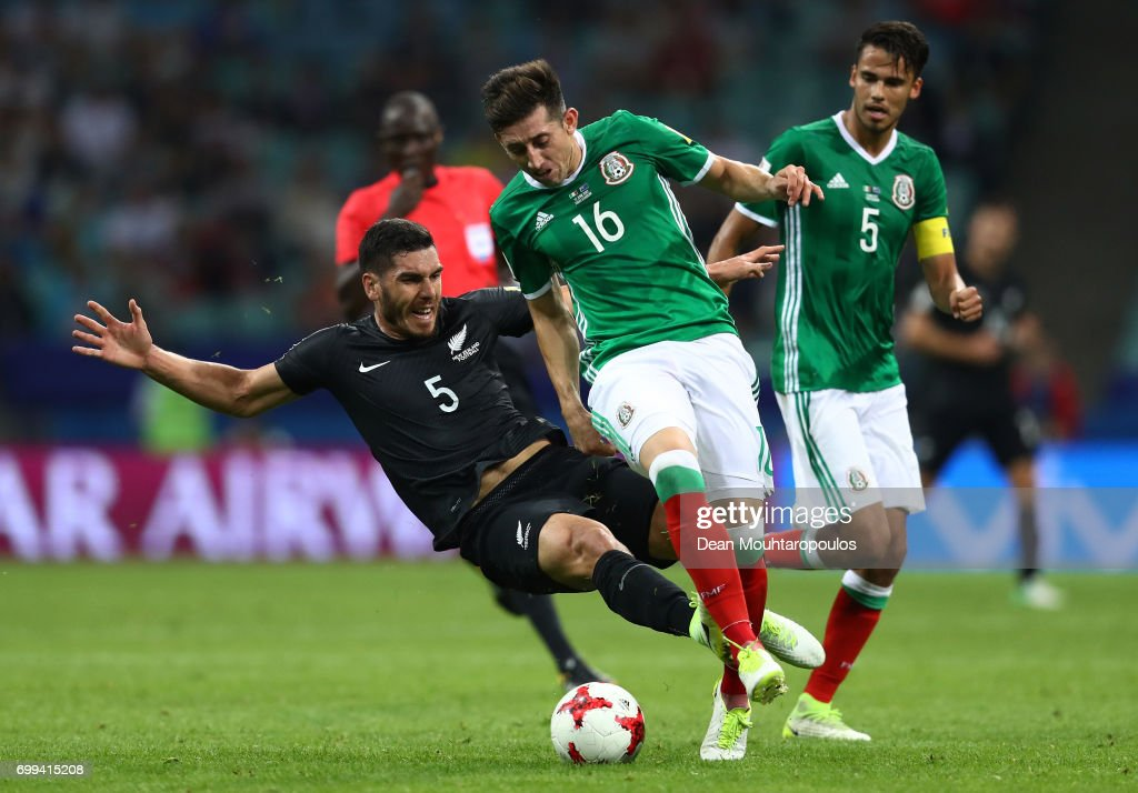 Michael Boxall of New Zealand fouls Hector Herrera of Mexico during the FIFA Confederations Cup Russia 2017 Group A match between Mexico and New Zealand at Fisht Olympic Stadium on June 21, 2017 in Sochi, Russia.