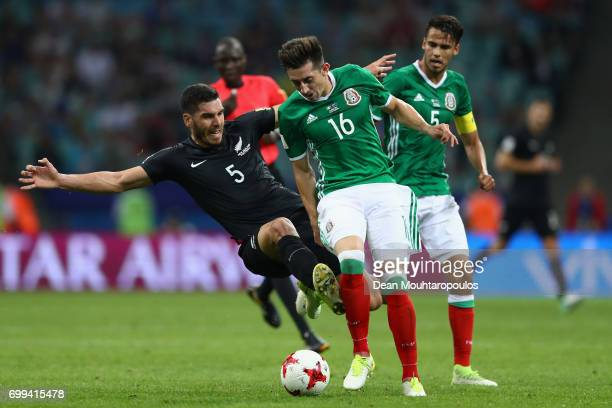 Michael Boxall of New Zealand fouls Hector Herrera of Mexico during the FIFA Confederations Cup Russia 2017 Group A match between Mexico and New...
