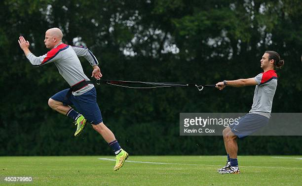 Michael Bradley and Graham Zusi of the United States work out during their training session at Sao Paulo FC on June 10 2014 in Sao Paulo Brazil
