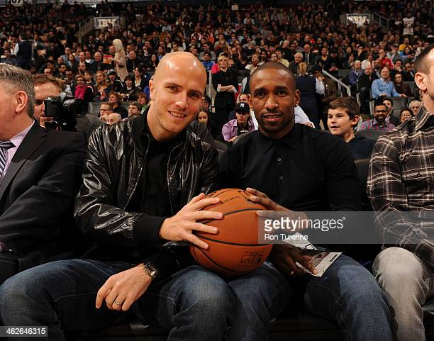 Michael Bradley and Jermain Defoe of Toronto FC of Major League Soccer attend the Milwaukee Bucks game against the Toronto Raptors on January 13 2014...