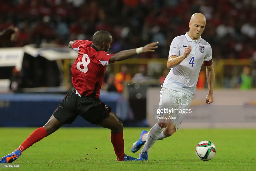 <a gi-track='captionPersonalityLinkClicked' href=/galleries/search?phrase=Michael+Bradley+-+Soccer+Player&family=editorial&specificpeople=7022299 ng-click='$event.stopPropagation()'>Michael Bradley</a> beats Trinidad and Tobago's #8 <a gi-track='captionPersonalityLinkClicked' href=/galleries/search?phrase=Khaleem+Hyland&family=editorial&specificpeople=5366394 ng-click='$event.stopPropagation()'>Khaleem Hyland</a> with an attacking move to his left during a World Cup Qualifier between Trinidad and Tobago and USA as part of the FIFA World Cup Qualifiers for Russia 2018 at Hasely Crawford Stadium on November 17, 2015 in Port of Spain, Trinidad & Tobago.